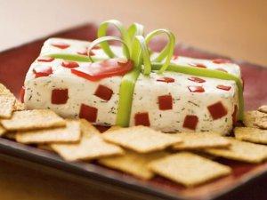 botana de queso en forma de regalo