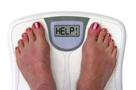 báscula midiendo peso corporal